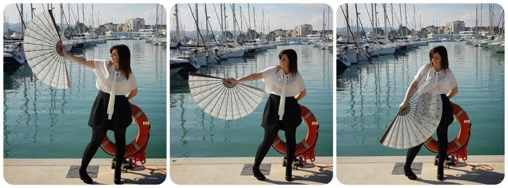 Raquel con abanico de encaje en el puerto de Denia, una forma de alimentar el alma.